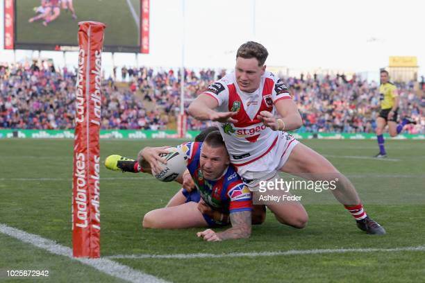 Shaun KennyDowall of the Knights attempts to score a try during the round 25 NRL match between the Newcastle Knights and the St George Illawarra...