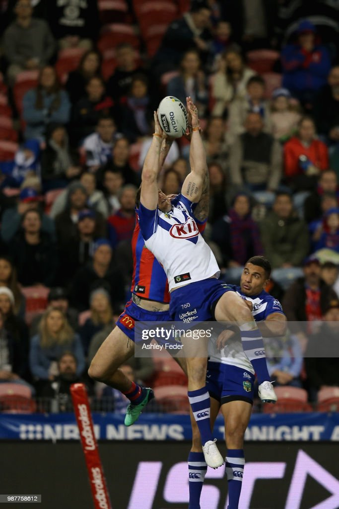 Shaun Kenny-Dowall of the Knights contests the ball against Jeremy Marshall-King of the Bulldogs during the round 16 NRL match between the Newcastle Knights and the Canterbury Bulldogs at McDonald Jones Stadium on June 30, 2018 in Newcastle, Australia.