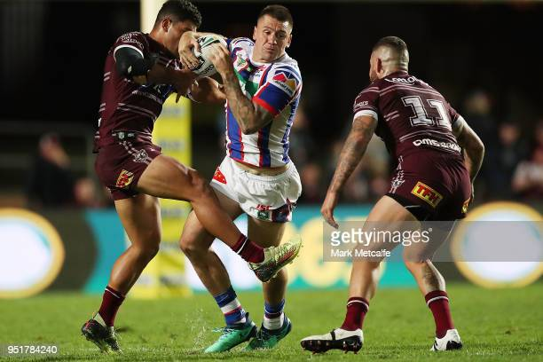 Shaun KennyDowall of the Knights is tackled during the Round eight NRL match between the ManlyWarringah Sea Eagles and the Newcastle Knights at...