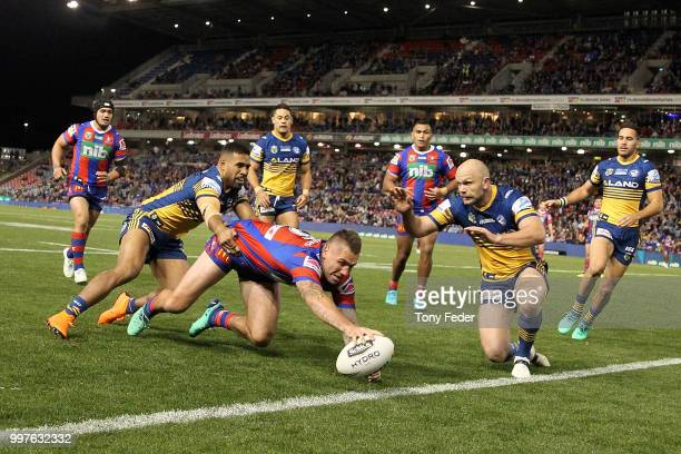 Shaun KennyDowall of the Knights scores a try during the round 18 NRL match between the Newcastle Knights and the Parramatta Eels at McDonald Jones...