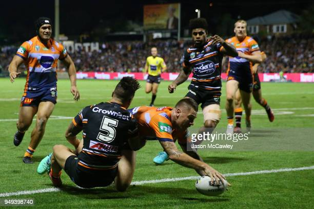 Shaun KennyDowall of the Knights scores a try during the round seven NRL match between the Wests Tigers and the Newcastle Knights at Scully Park on...