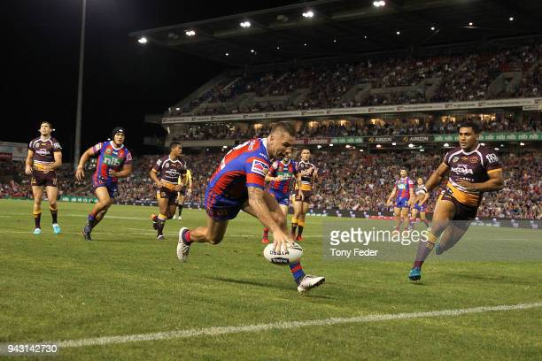 Shaun KennyDowall of the Knights scores but it was given a no try during the round five NRL match between the Newcastle Knights and the Brisbane...