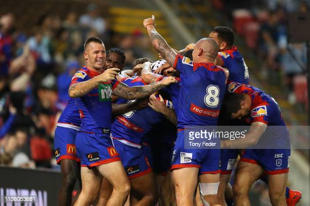 Shaun Kenny-Dowall of the Newcastle Knights celebrates a try with team mate David Klemmer of the Newcastle Knights during round one NRL match between...