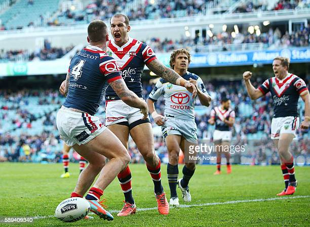 Shaun KennyDowall of the Roosters celebrates his try with team mate Blake Ferguson during the round 23 NRL match between the Sydney Roosters and the...