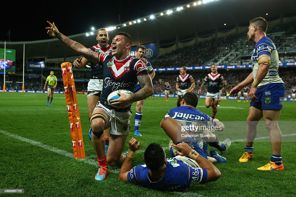 Shaun Kenny-Dowall of the Roosters celebrates scoring a try during the First NRL Semi Final match between the Sydney Roosters and the Canterbury Bulldogs at Allianz Stadium on September 18, 2015 in Sydney, Australia.