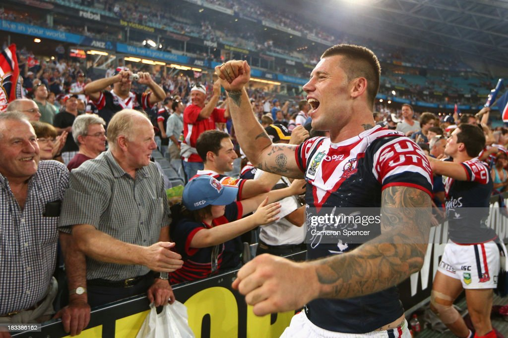 Shaun Kenny-Dowall of the Roosters celebrates with fans after winning the 2013 NRL Grand Final match between the Sydney Roosters and the Manly Warringah Sea Eagles at ANZ Stadium on October 6, 2013 in Sydney, Australia.