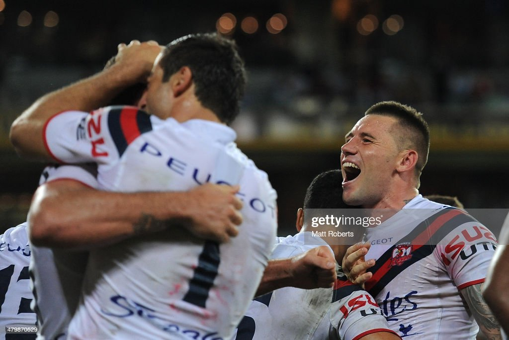 Shaun Kenny-Dowall of the Roosters celebrates with tema mates a try by Boyd Cordner during the round three NRL match between the Brisbane Broncos and the Sydney Roosters at Suncorp Stadium on March 21, 2014 in Brisbane, Australia.