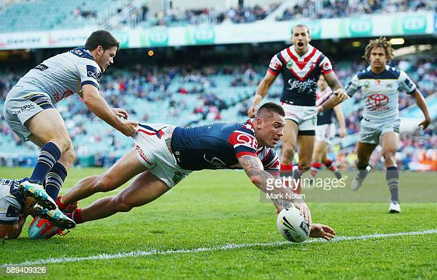 Shaun KennyDowall of the Roosters dives to score a try during the round 23 NRL match between the Sydney Roosters and the North Queensland Cowboys at...