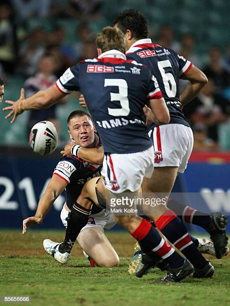 Shaun KennyDowall of the Roosters gets a pass away during the round three NRL match between the Wests Tigers and the Sydney Roosters at the Sydney...