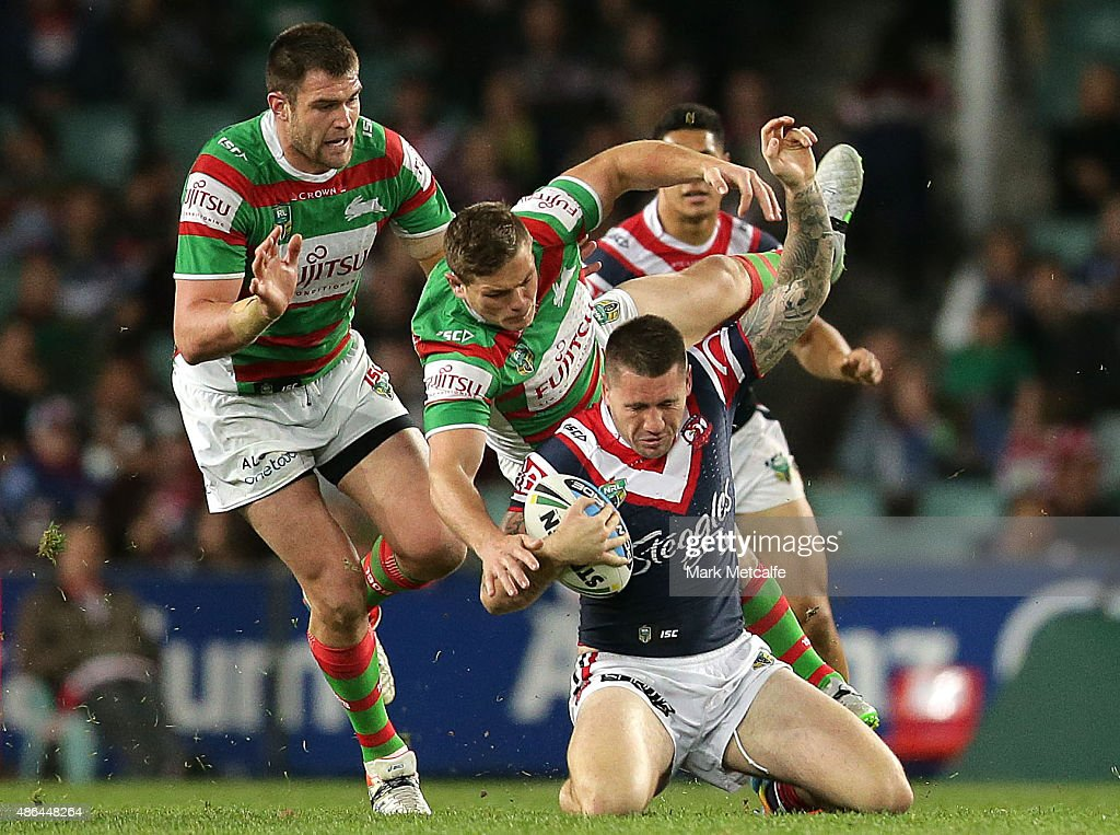Shaun Kenny-Dowall of the Roosters is tackled during the round 26 NRL match between the Sydney Roosters and the South Sydney Rabbitohs at Allianz Stadium on September 4, 2015 in Sydney, Australia.