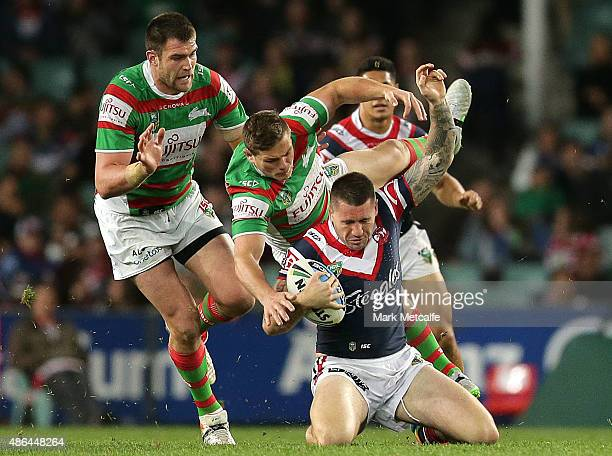 Shaun KennyDowall of the Roosters is tackled during the round 26 NRL match between the Sydney Roosters and the South Sydney Rabbitohs at Allianz...