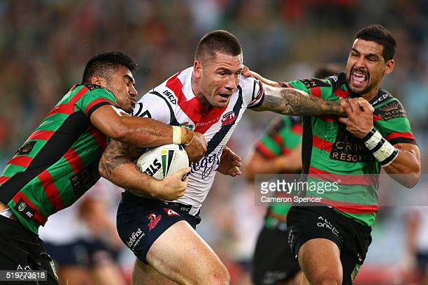 Shaun KennyDowall of the Roosters is tackled during the round six NRL match between the South Sydney Rabbitohs and the Sydney Roosters at ANZ Stadium...