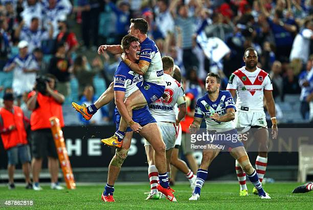 Shaun Lane of the Bulldogs celebrates his try with team mate Damien Cook during the NRL Elimination Final match between the Canterbury Bulldogs and...