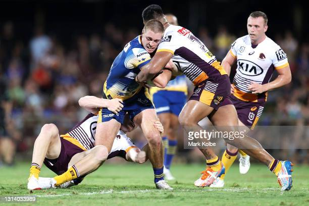 Shaun Lane of the Eels is tackled during the round seven NRL match between the Parramatta Eels and the Brisbane Broncos at TIO Stadium, on April 23...