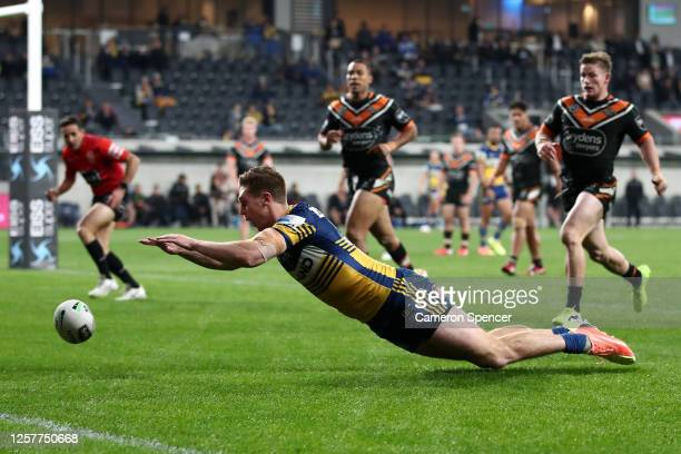 Shaun Lane of the Eels scores a try during the round 11 NRL match between the Parramatta Eels and the Wests Tigers at Bankwest Stadium on July 23...