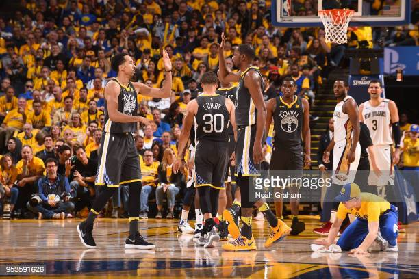 Shaun Livingston and Kevin Durant of the Golden State Warriors high five in Game Two of the Western Conference Semifinals against the New Orleans...