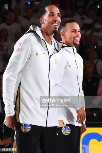 Shaun Livingston and Stephen Curry of the Golden State Warriors smile during the ring ceremony before the game against the Houston Rockets on October...
