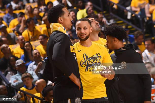 Shaun Livingston and Stephen Curry of the Golden State Warriors talk in Game Two of the Western Conference Semifinals against the New Orleans...