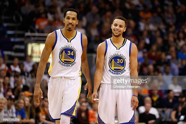 Shaun Livingston and Stephen Curry of the Golden State Warriors during the NBA game against the Phoenix Suns at Talking Stick Resort Arena on...