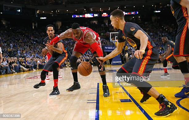 Shaun Livingston and Stephen Curry of the Golden State Warriors try to steal the ball from Dwight Howard of the Houston Rockets at ORACLE Arena on...