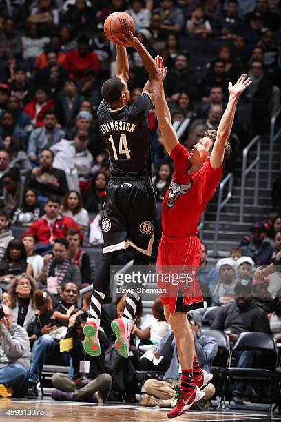 Shaun Livingston of the Brooklyn Nets attempts a shot against Mike Dunleavy of the Chicago Bulls on December 25 2013 at Barclays Center in Brooklyn...