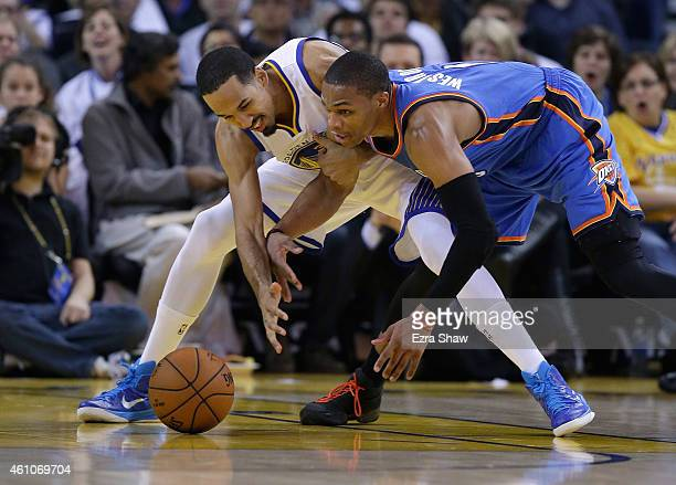 Shaun Livingston of the Golden State Warriors and Russell Westbrook of the Oklahoma City Thunder go for a loose ball at ORACLE Arena on January 5...