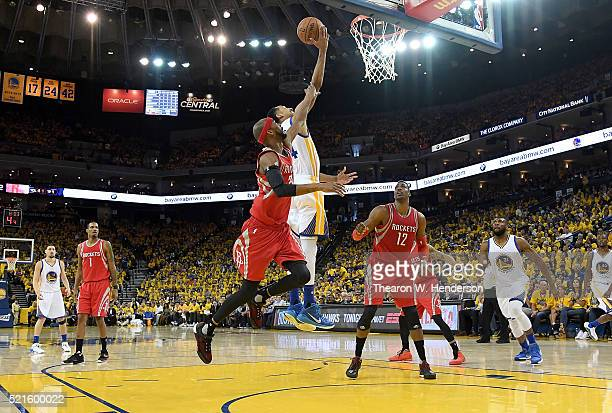 Shaun Livingston of the Golden State Warriors attempts a layup over Corey Brewer of the Houston Rockets in the third quarter in Game One of the...