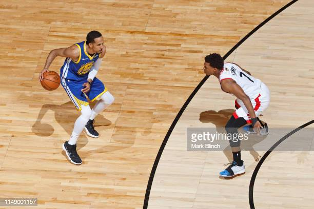 Shaun Livingston of the Golden State Warriors dribbles the ball while guarded by Kyle Lowry of the Toronto Raptors during Game Five of the NBA Finals...
