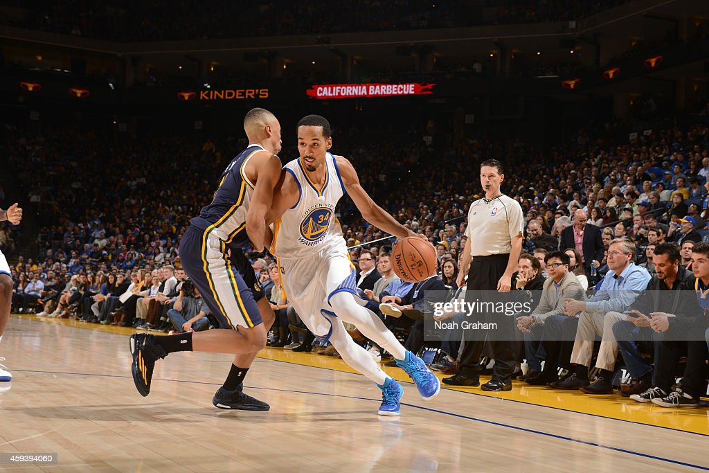 Shaun Livingston #34 of the Golden State Warriors drives against Dante Exum #11 of the Utah Jazz on November 21, 2014 at Oracle Arena in Oakland, California.