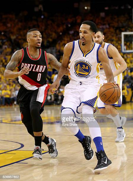 Shaun Livingston of the Golden State Warriors drives on Damian Lillard of the Portland Trail Blazers during Game One of the Western Conference...