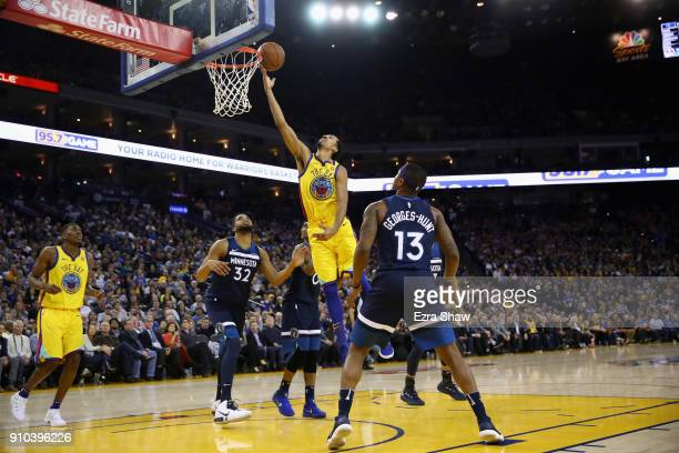 Shaun Livingston of the Golden State Warriors goes up for a shot on KarlAnthony Towns and Marcus GeorgesHunt of the Minnesota Timberwolves at ORACLE...