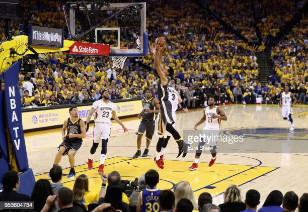 Shaun Livingston of the Golden State Warriors goes up to dunk the ball on Nikola Mirotic of the New Orleans Pelicans during Game Two of the Western...