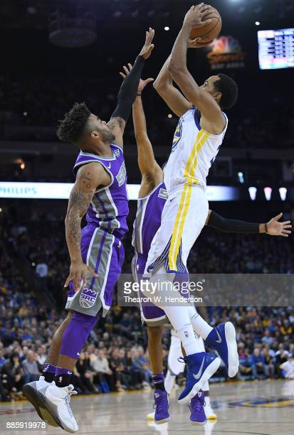 Shaun Livingston of the Golden State Warriors goes up to shoot over Frank Mason III of the Sacramento Kings during their NBA basketball game at...