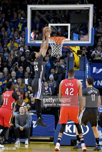 Shaun Livingston of the Golden State Warriors goes up to slam dunk the ball against the New Orleans Pelicans in the first quarter of their NBA...