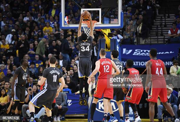 Shaun Livingston of the Golden State Warriors goes up to slam dunk the ball against the New Orleans Pelicans in the second quarter of their NBA...