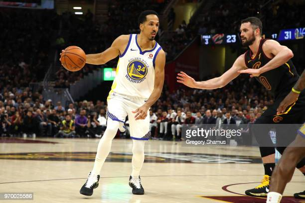 Shaun Livingston of the Golden State Warriors handles the ball against Kevin Love of the Cleveland Cavaliers in the first half during Game Four of...