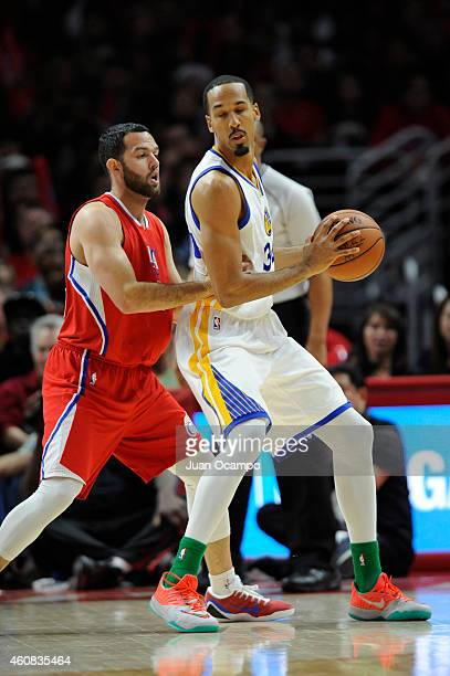Shaun Livingston of the Golden State Warriors handles the basketball against Jordan Farmar of the Los Angeles Clippers at STAPLES Center on December...