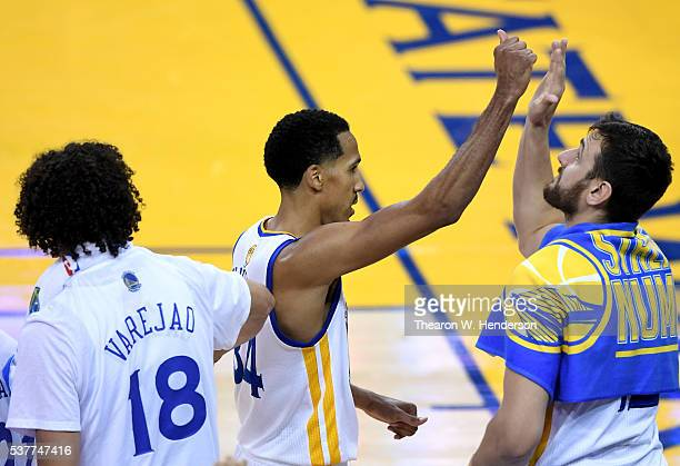 Shaun Livingston of the Golden State Warriors high fives teammates after he is taken out of the game in the second half while taking on the Cleveland...