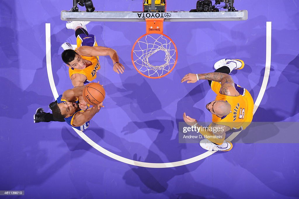 Shaun Livingston #34 of the Golden State Warriors jumps for a rebound against Jeremy Lin #17 of the Los Angeles Lakers on December 23, 2014 at Staples Center in Los Angeles, California.