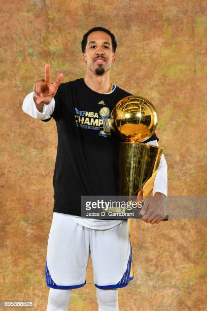 Shaun Livingston of the Golden State Warriors poses for a portrait with the Larry O'Brien Trophy after defeating the Cleveland Cavaliers in Game Five...