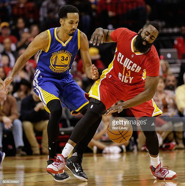 Shaun Livingston of the Golden State Warriors reaches in to knock the ball away from James Harden of the Houston Rockets in the second half at Toyota...