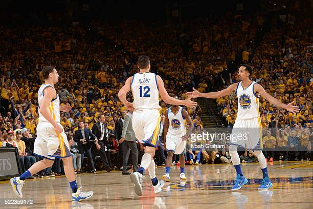Shaun Livingston of the Golden State Warriors shakes hands with his teammates during the game against the Houston Rockets in Game Two of the Western...