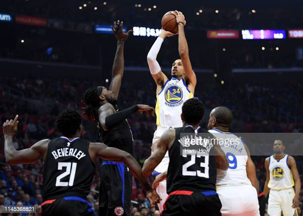 Shaun Livingston of the Golden State Warriors shoots a jumper in front of Montrezl Harrell of the LA Clippers in the first half during Game Six of...