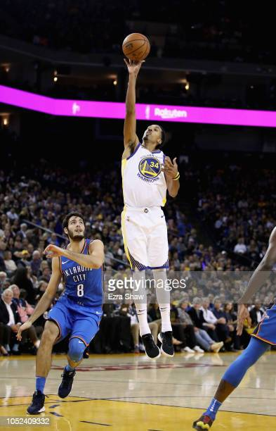 Shaun Livingston of the Golden State Warriors shoots over Alex Abrines of the Oklahoma City Thunder at ORACLE Arena on October 16 2018 in Oakland...