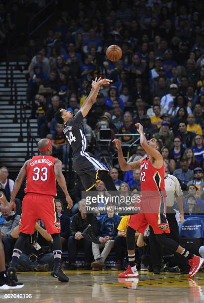 Shaun Livingston of the Golden State Warriors shoots over Alexis Ajinca of the New Orleans Pelicans in the first quarter of their NBA Basketball game...