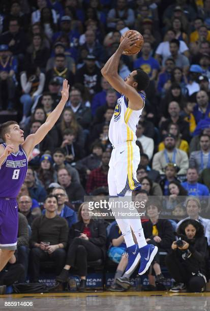 Shaun Livingston of the Golden State Warriors shoots over Bogdan Bogdanovic of the Sacramento Kings during their NBA basketball game at ORACLE Arena...