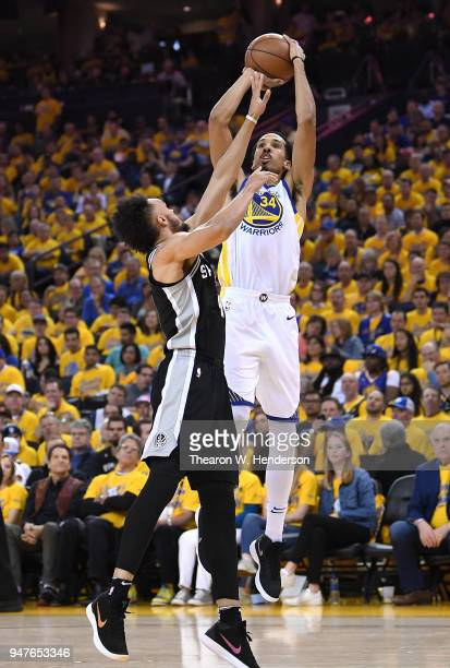 Shaun Livingston of the Golden State Warriors shoots over Derrick White of the San Antonio Spurs in the third quarter during Game One of the first...