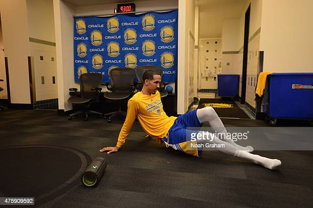 Shaun Livingston of the Golden State Warriors stretches before the game the game against the Cleveland Cavaliers in Game One of the 2015 NBA Finals...