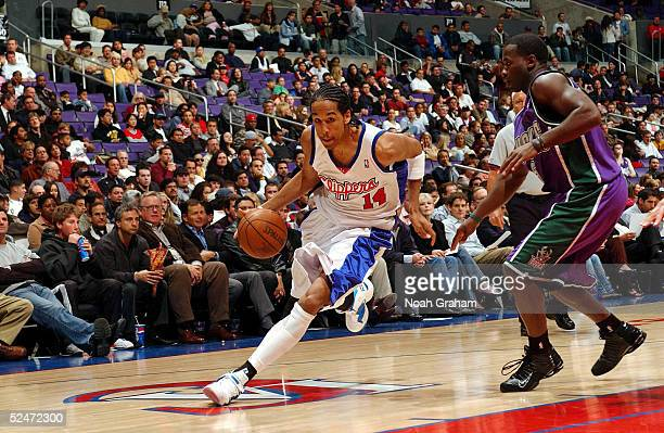 Shaun Livingston of the Los Angeles Clippers drives to the hoop past Anthony Goldwire of the Milwaukee Bucks on March 23, 2005 at the Staples Center...