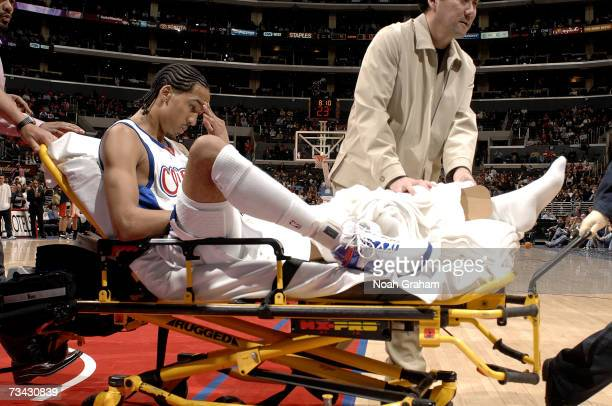 Shaun Livingston of the Los Angeles Clippers gets carted off of the court after suffering a knee injury against the Charlotte Bobcats on February 26,...